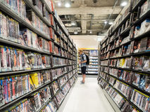 Unidentified people choose dvd in rental shop. Stock Images