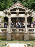 Unidentified people collecting water from the Otowa-no-taki wate. Kyoto,Japan - June 28, 2014 : unidentified people collecting water from the Otowa-no-taki Stock Photo