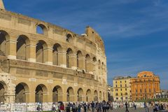 Unidentified people by Colloseum in Rome, Italy. It is most remarkable landmark of Rome and Italy. Colosseum is an elliptical amphitheatre in the centre of the royalty free stock images