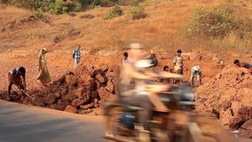 Unidentified people construction road in India. Goa, India – February 25, 2016: Unidentified people construction road in India stock video