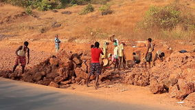 Unidentified people construction road in India. Goa, India – February 25, 2016: Unidentified people construction road in India stock video footage