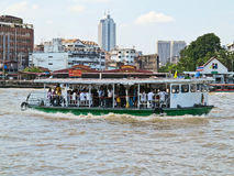 Unidentified people cross Chao Phraya river by ferry boat in Bangkok, Thailand. Unidentified people cross Chao Phraya river by ferry boat in Bangkok Thailand Stock Images