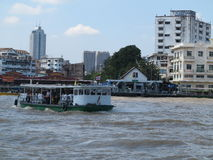 Unidentified people cross Chao Phraya river by ferry boat in Bangkok, Thailand. Unidentified people cross Chao Phraya river by ferry boat in Bangkok Thailand Royalty Free Stock Photo