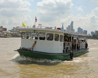 Unidentified people cross Chao Phraya river by ferry boat in Bangkok, Thailand. BANGKOK, THAILAND - OCTOBER 2, 2016: Unidentified people cross Chao Phraya river Stock Photos