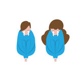 Unidentified people cry and hug their knees. People sit and hug their knees crying Stock Image