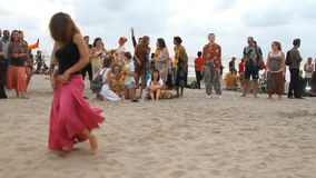 Unidentified people dancing on the beach. stock footage
