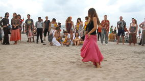 Unidentified people dancing on the beach stock footage