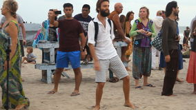 Unidentified people dancing on the beach. Goa state Arambol beach. stock video