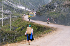 Unidentified people of diferent ethnic groups leaving  Lung Phin Stock Photos
