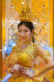 Unidentified people dress up golden shade Thai traditional costume Stock Photos