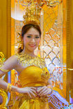 Unidentified people dress up golden shade Thai traditional costume Royalty Free Stock Photo