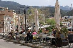 Unidentified people eating in a restaurant in Port de Soller, Majorca, Spain. PORT DE SOLLER, MALLORCA, SPAIN, APRIL 6, 2016: Unidentified people eating in a Stock Photography