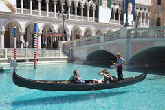 Unidentified people enjoy gondola ride at Grand Canal at The Venetian Resort Hotel Casino Stock Photo