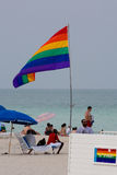Unidentified people and the gay flag on the famous beach of Miam Stock Image