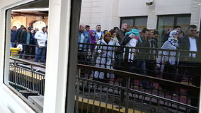 Unidentified people get off the city ferryboat on Kadikoy pier. Over than 200,000 passengers use ferryboats daily in Istanbul stock video footage