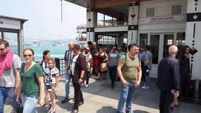Unidentified people getting out of the ferry boat at Besiktas Pier. Istanbul, Turkey - June 03, 2017: Passengers getting out of the ferry boat at Besiktas Pier stock video footage