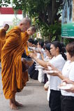 Unidentified  people give food offerings to Buddhist monks Royalty Free Stock Photography