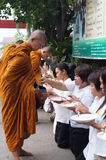 Unidentified  people give food offerings to Buddhist monks Royalty Free Stock Photos