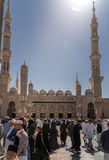 Unidentified people go out at the Nabawi Mosque, Saudi Arabia Royalty Free Stock Photo