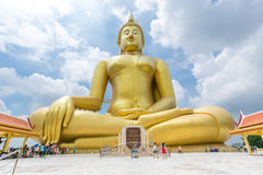 Unidentified people go to pray at big statue of buddha Royalty Free Stock Image