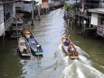 Unidentified people go to travel by boat on the river at Samut Prakan province, Thailand Stock Images