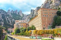 Unidentified people are going to Montserrat Benedictine monastery, religious center of Catalonia, Montserrat, Spain stock photography