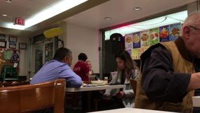 Unidentified people have dinner inside Chinese restaurant. Pan shot of unidentified people have dinner inside Chinese restaurant stock video