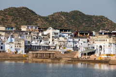 Unidentified people at holy Pushkar Sarovar lake in India Stock Photo