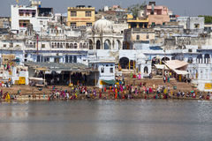 Unidentified people at holy Pushkar Sarovar lake in India Stock Photos