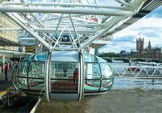 Unidentified people inside London Eye  cabin. London Royalty Free Stock Photography