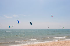 Unidentified people involved in kitesurfing Stock Photos