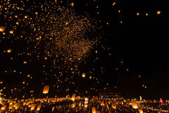 Unidentified People launch sky lanterns to the sky in Loy Kratong festival Royalty Free Stock Photo