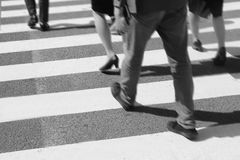 Unidentified people legs crossing street Stock Photography