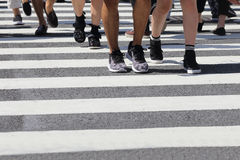 Unidentified people legs crossing street Stock Images