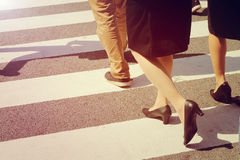 Unidentified people legs crossing street Royalty Free Stock Photos