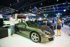 Unidentified people look at porsche 911 Carrera S Royalty Free Stock Photos