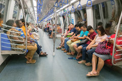 Unidentified people in The Mass Rapid Transit (MRT) train in Singapore Stock Photo