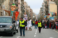 Unidentified people in the middle of Sants Street in carnival parade Stock Image