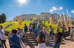 Unidentified people near the Grand Cascade in Peterhof Palace Royalty Free Stock Photos