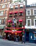 Unidentified people near small pub at Covent Garden neighborhood, London. Stock Photo