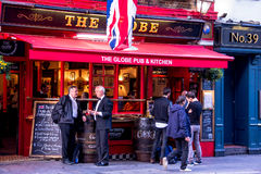 Unidentified people near small pub at Covent Garden neighborhood, London. Royalty Free Stock Photography