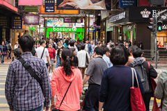 Unidentified people near Time Square mall. HONG KONG - MARCH 19: Unidentified people near Time Square mall on March, 19, 2013 in Hong Kong. Time Square mall is a Royalty Free Stock Image