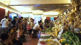 Unidentified people pay respect Buddha statues at the Golden Mount, Wat Saket temple stock footage