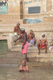Unidentified people performing Puja on the banks of the Ganges r Stock Photo