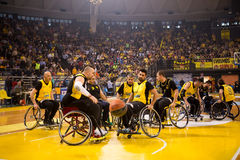 Unidentified people play a friendly game of wheelchair basketbal Stock Image