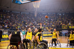Unidentified people play a friendly game of wheelchair basketbal Royalty Free Stock Photos