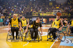 Unidentified people play a friendly game of wheelchair basketbal Stock Photography