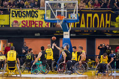 Unidentified people play a friendly game of wheelchair basketbal Royalty Free Stock Photography