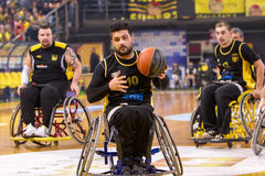 Unidentified people play a friendly game of wheelchair basketbal Stock Images