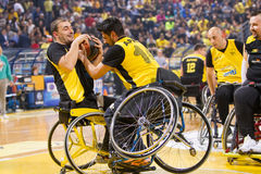 Unidentified people play a friendly game of wheelchair basketbal Stock Photo